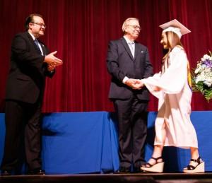 President Richard Karsten '81 and Principal Br. Thomas Schady greet graduate Deanna Aliperti '15