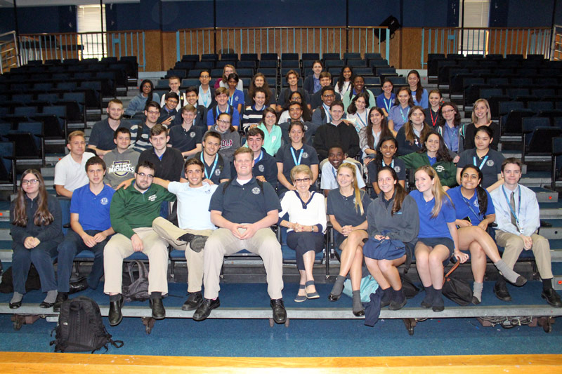 Celia Kenner (front row center) poses with Molloy students during her visit.