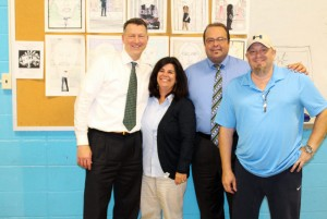L-R: John Mangan '82, Admissions Director Leslie Poole-Petit, President Richard Karsten '81, and art teacher Glen DaGrossa.