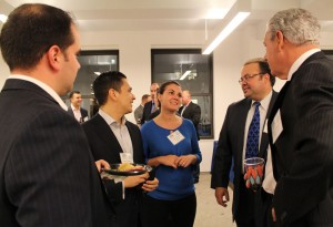 Natalia Dudek-Malecki '08 speaks with President Richard Karsten '81 and Jerry Schumm '68