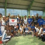 Students in the Dominican Republic wear their donated Molloy jerseys.