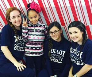 JV Softball Players visit with children with special needs.